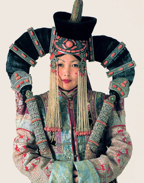 4fd5ac4a636 Mongolian woman in the folk costume with a very extraordinary headdress  (this shape of a female headgear is typical for the Central Mongolia).